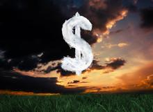 Cloud Dollar Against Green Grass Under Dark Blue And Orange Sky