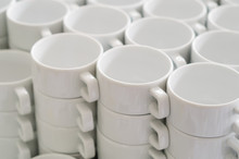 Stack Of White Porcelain Cups