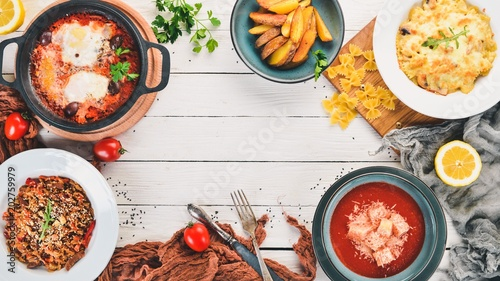Fototapeta Food. Set of dishes on the table. On a wooden background. Top view. Copy space. obraz