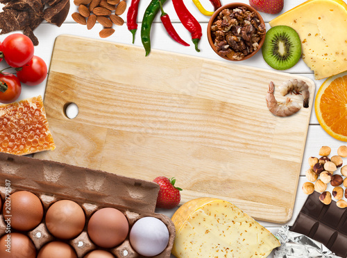 Collage of allergic food on white wooden background, top view Wallpaper Mural