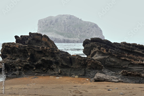 Photo  Aketx island east of Gaztelugatxe islet across Senaia Kala-cove