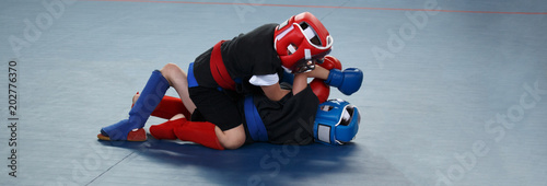 Poster de jardin Combat Banner. Martial arts training. Two boys are fighting
