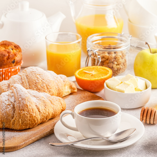 Continental breakfast with fresh croissants, orange juice and coffee Canvas Print