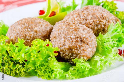 Deurstickers Klaar gerecht Icli kofta. Turkish dish. Meatballs with bulgur