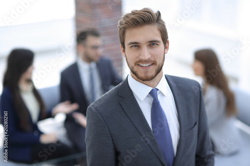 Handsome business man working at the office.