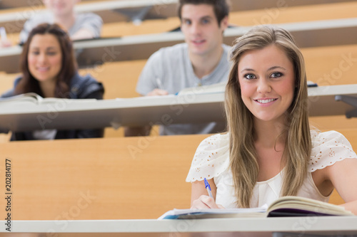 Students sitting at the lecture hall smiling