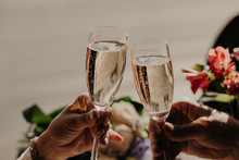 Bride And Groom Toast And Clin...