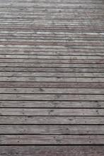 Background Of Wide  Gray Brown Wooden Floor Deck Outdoors In Perspective.