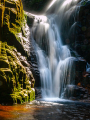 Panel Szklany Eko Kamienczyk waterfall near SzklarskaPoreba in Giant mountains or Karkonosze, Poland. Long time exposure.
