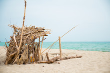 Robinson Crusoe Refugee Handmade Shelter By The Sea In Abandoned Shore Of Isolated Island