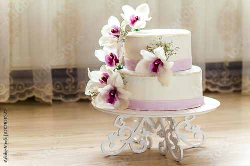 Beautiful Wedding Cake With Flowers Close Up Of Blurr