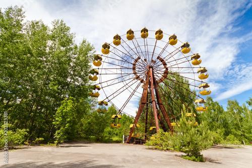 Fotografie, Obraz  The abandoned Ferris wheel in the amusement park in a dead city Pripyat, Ukraine
