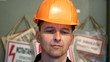 Portrait of an experienced worker in the workplace. Handsome man in helmet looking at camera.