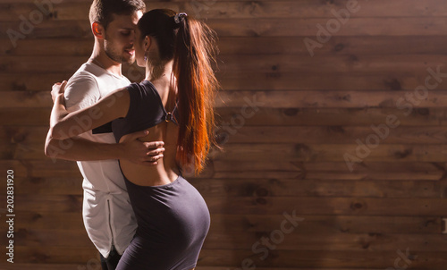 Poster Dance School Active happy adults dancing bachata together in dance class