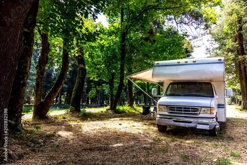 Fotografija Family trip in motorhome in forest or park in South Chile
