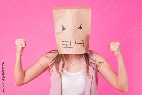Stampa su Tela Concept of negative emotions - Angry woman with a paper bag on his face