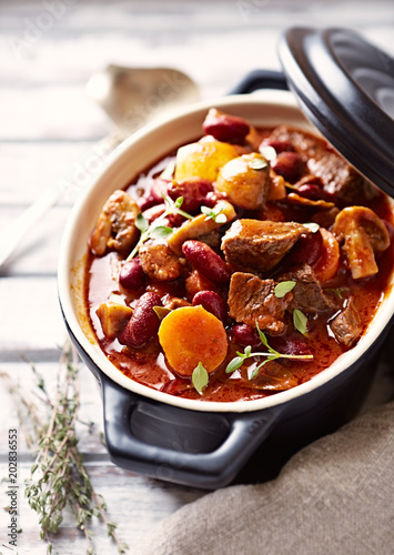 Spoed Fotobehang Klaar gerecht Beef goulash with mushrooms and vegetables