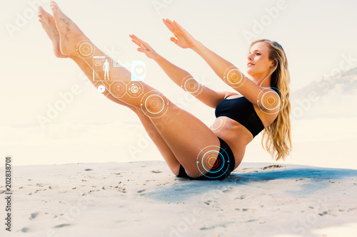 Poster  Fit blonde in core balance pilates pose on the beach against fitness interface