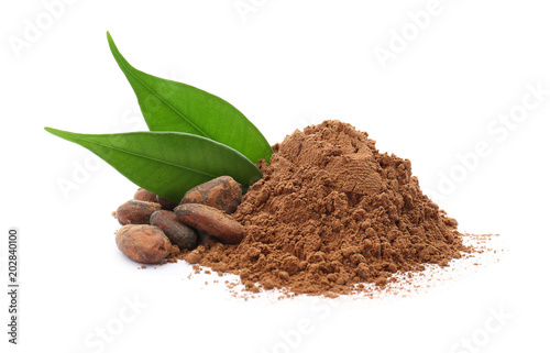 Cocoa powder and beans on white background