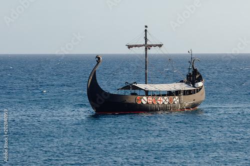 Keuken foto achterwand Schip old black ship in the open sea