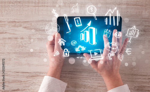 Papiers peints Secheresse Caucasian business hands holding tablet with blue statistics and finances screen
