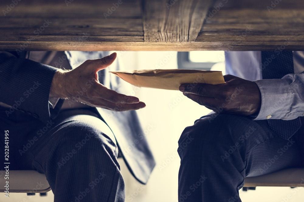 Fototapeta Business people sending documents under the table