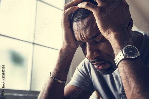 Black guy stressting and headache Tablou Canvas