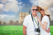 Vacationing couple against notre dame cathedral