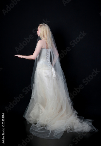 Full Length Portrait Of Woman Wearing White Bridal Gown
