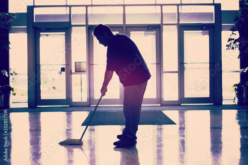 Fotografija Janitor mopping the floor