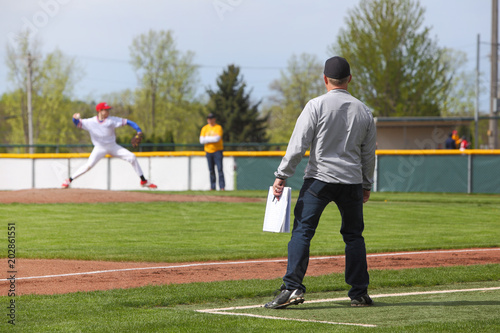 Baseball coach standing at third base