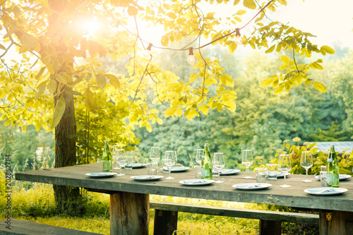 Fotoposter Picknick Table is set and waiting for dining in countryside