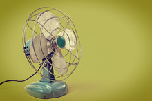 Aqua Color Vintage Fan On A Gr...