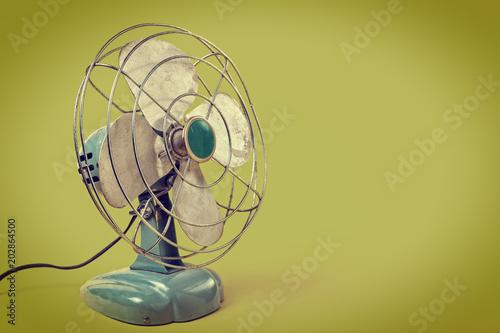 Fototapeta Aqua color vintage fan on a green background obraz