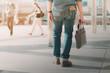 man walking in city.