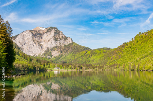 Foto auf Gartenposter Reflexion mountain reflecting in calm lake