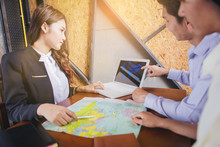 Couples Planning Travel Abroad. Choose From The Map Of The Tour Guide.