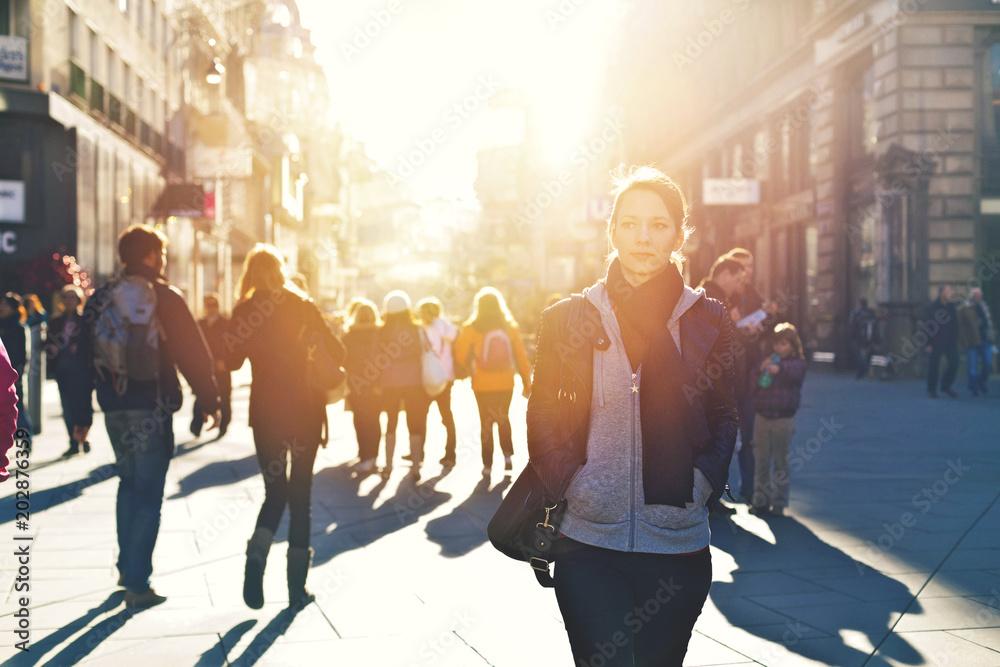 Fototapety, obrazy: Urban girl striding through city area