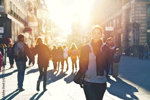 Urban girl striding through city area - 202876359
