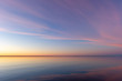 Colorful sky at dusk over bay