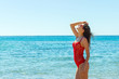 beautiful happy woman on tropical beach in swimsuit and sunglassses