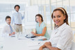 Businesswoman with colleagues in boardroom meeting