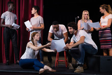 Actors Reading Their Scripts On Stage