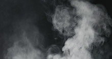 Vapor Steam Rising Over Black ...