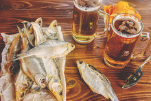 Dried Fish And Beer. Selective Focus.
