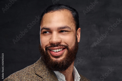 Close-up portrait of a smiling handsome bearded African-American businessman in a brown classic jacket Fototapet
