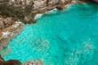 Cliff in Petrovac, Montenegro. Turquoise water adriatic sea. Beautiful mediterranean landscape.