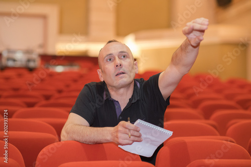 director in auditorium of movie theater