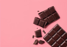 Dark Chocolate On Pink Backgro...