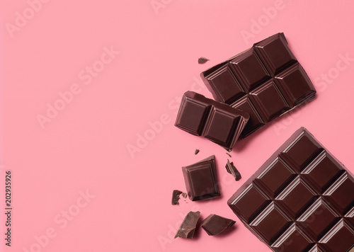 Dark chocolate on pink background Fototapeta